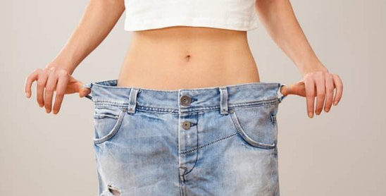 Woman With Too Large Clothes From Eating Almonds For Weight Loss