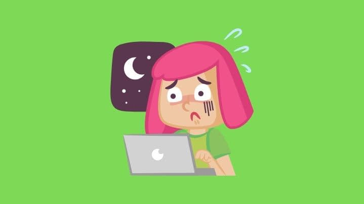 woman at computer displaying symptoms of a panic attack icon