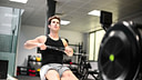 man rowing on the top of the line rowing machine