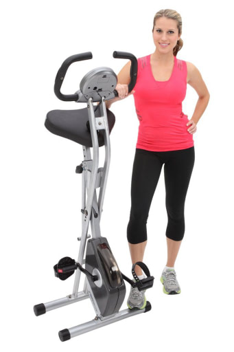 female standing by the best folding exercise bike