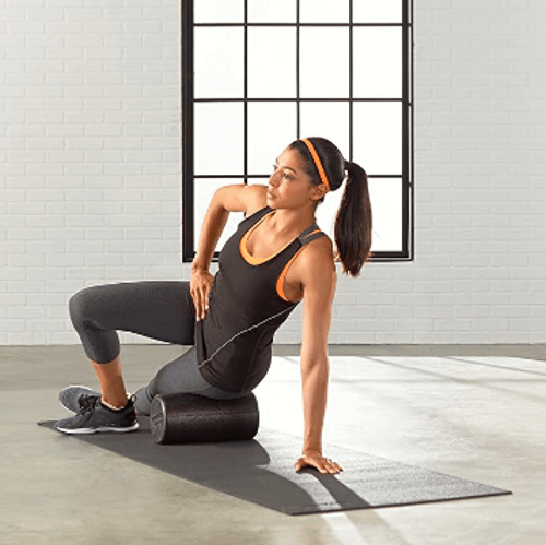 woman on the floor using the best foam rollers for muscle pain and soreness