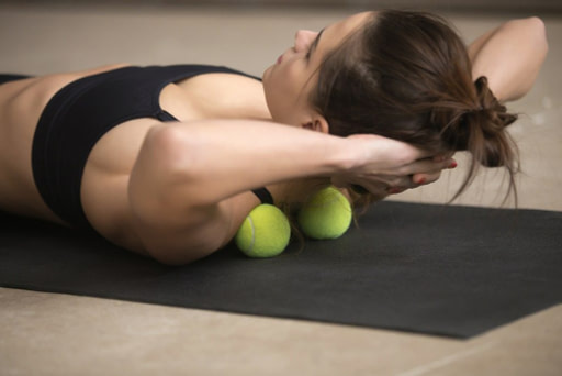 Using tennis balls for a roller massage