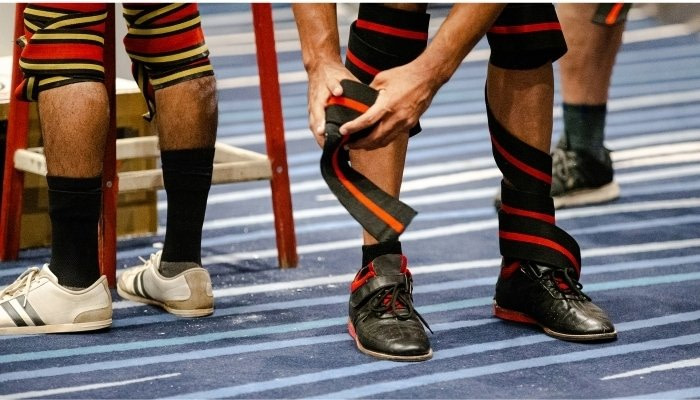Wrapping Knees with Knee Wraps for power lifting