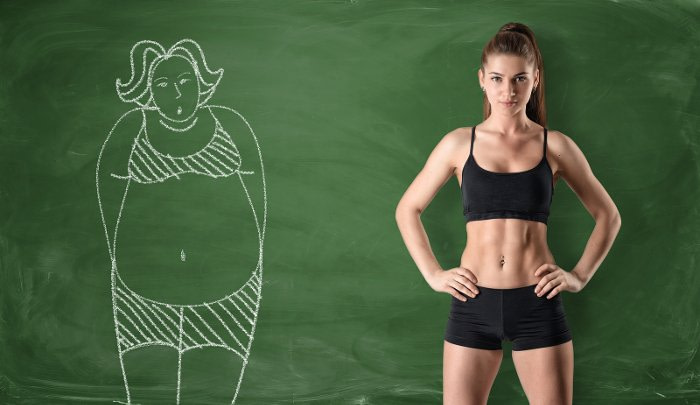 Woman deciding how long she should exercise for weight loss