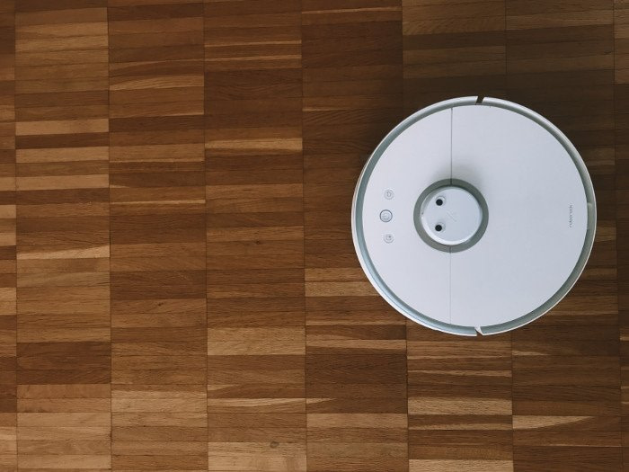 vacuuming for exercise with a robotic vacuum