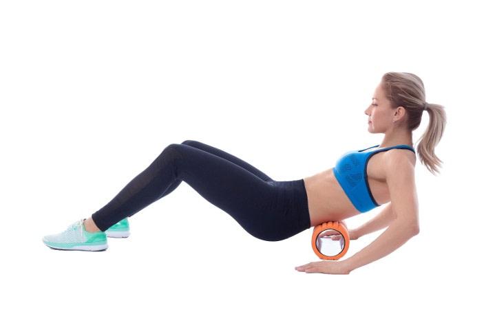 woman using foam roller for back pain