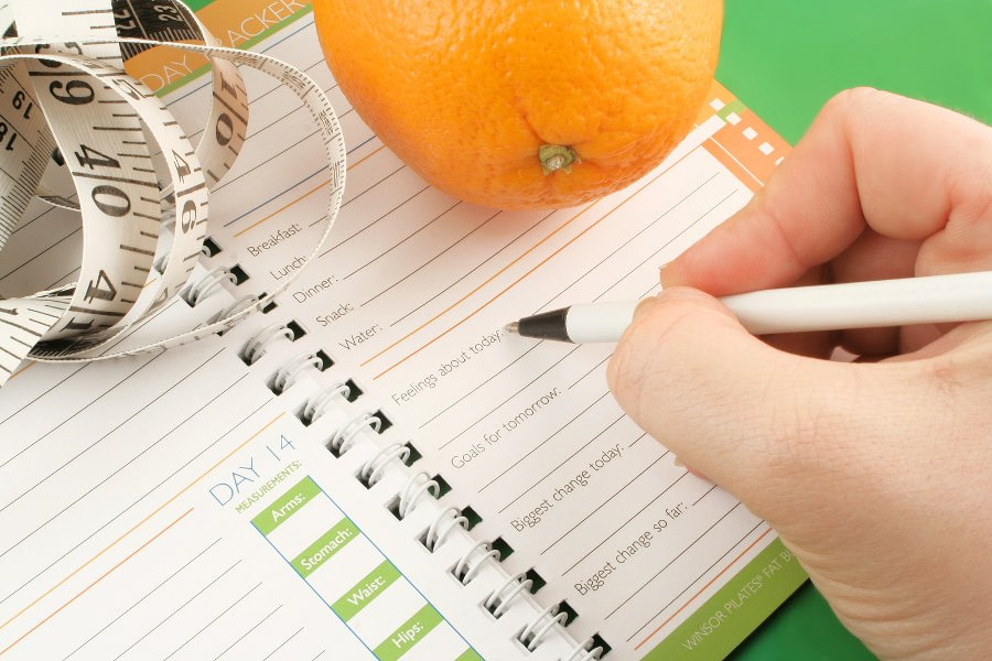 woman journaling for weight loss